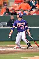 Clemson Tigers first baseman Chris Williams (27) swings at a pitch during a game against the Maine Black Bears at Doug Kingsmore Stadium on February 20, 2016 in Clemson, South Carolina. The Tigers defeated the Black Bears 9-4. (Tony Farlow/Four Seam Images)