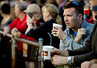 LOUISVILLE, KY - MAY 02: A spectator drinks coffee while watching morning workouts at Churchill Downs on May 2, 2018 in Louisville, Kentucky. (Photo by Scott Serio/Eclipse Sportswire/Getty Images)