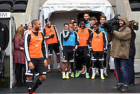 Wednesday, 23 April 2014<br /> Pictured: Swansea players hold back to allow Ashley Williams (LEFT) to take to the pitch first.<br /> Re: Swansea City FC are holding an open training session for their supporters at the Liberty Stadium, south Wales,