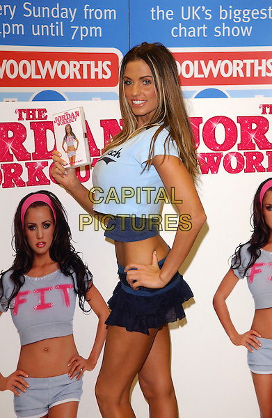 JORDAN - KATIE PRICE.DVD Signing & Trolley Dash at Woolworths, Lakeside Shopping Centre, West Thurrock, Essex, UK..January 5th, 2006.Ref: FIN.half length skirt blue ruffles hand on hip .www.capitalpictures.com.sales@capitalpictures.com.© Capital Pictures.