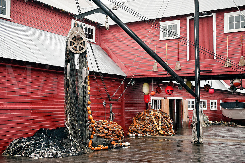 Fishing boats and and crab traps displayed at Icy Straight Point historic cannery, Hoonah, AK, Alaska, USA