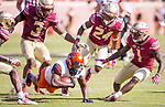 Syracuse wide receiver Steve Ishmael dives for extra yardage after a reception as Florida State defensive backs Derwin James (3), Cyrus Fagan (24) and Levant Taylor close in during the second half of an NCAA college football game in Tallahassee, Fla., Saturday, Nov. 4, 2017. Florida State defeated Syracuse 27-24. (AP Photo/Mark Wallheiser)