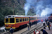 Machu Pichu Station, Peru. Machu Pichu Railway - autowagon tourist train; people getting on and off.