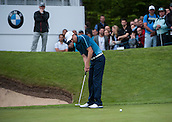 22.05.2015. Wentworth, England. BMW PGA Golf Championship. Round 2. Ross Fisher [ENG] putts on the 18th Green.