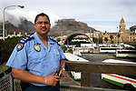 Neil Arendse, Assistant Chief of The City of Cape Town's Specialised Law Enforcement Services, overseeing the Vice Squad, standing The Grand Parade, in front of the Cape Town City Hall, with views of Table Mountain, where the official Fan Park & public viewing areas will be for football fans. He says to fans coming from all over the globe to South Africa for the world cup.  Fans enjoy what we have to offer in Cape Town, Table mountain, the vineyards, all the tourist sites. BUT we do not want you to come and enjoy, or exploit the ladies or children illegally offered for sex.
