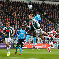 Plymouth Argyle's Oscar Threlkeld competing in the air with Fleetwood Town's Amari'i Bell<br /> <br /> Photographer Andrew Kearns/CameraSport<br /> <br /> The EFL Sky Bet League One - Plymouth Argyle v Fleetwood Town - Saturday 7th October 2017 - Home Park - Plymouth<br /> <br /> World Copyright &copy; 2017 CameraSport. All rights reserved. 43 Linden Ave. Countesthorpe. Leicester. England. LE8 5PG - Tel: +44 (0) 116 277 4147 - admin@camerasport.com - www.camerasport.com
