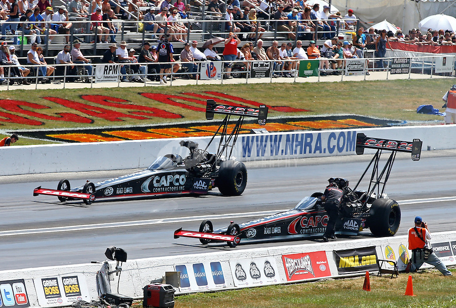 Sept. 2, 2013; Clermont, IN, USA: NHRA top fuel dragster driver Billy Torrence (far lane) sits alongside Steve Torrence during the US Nationals at Lucas Oil Raceway. Mandatory Credit: Mark J. Rebilas-