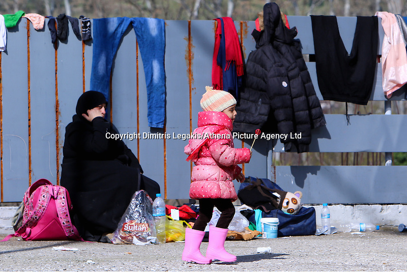 Pictured: A young girl at the road block Tuesday 23 February 2016<br /> Re: Migrants on their way back to Athens have been caught by the blocked off motorway at Tembi, where local farmers have closed off the road, protesting against pension and welfare reforms near Trikala, Greece.
