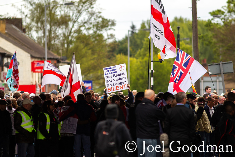 """© Joel Goodman - 07973 332324 . 05/05/2012 .  Luton , UK . A placard reading """" Not racist not violent no longer silent """" is raised . Approximately 1,500 people take part in an EDL ( English Defence League ) march in Luton , understood to have been policed by over 1,000 officers . Photo credit: Joel Goodman"""