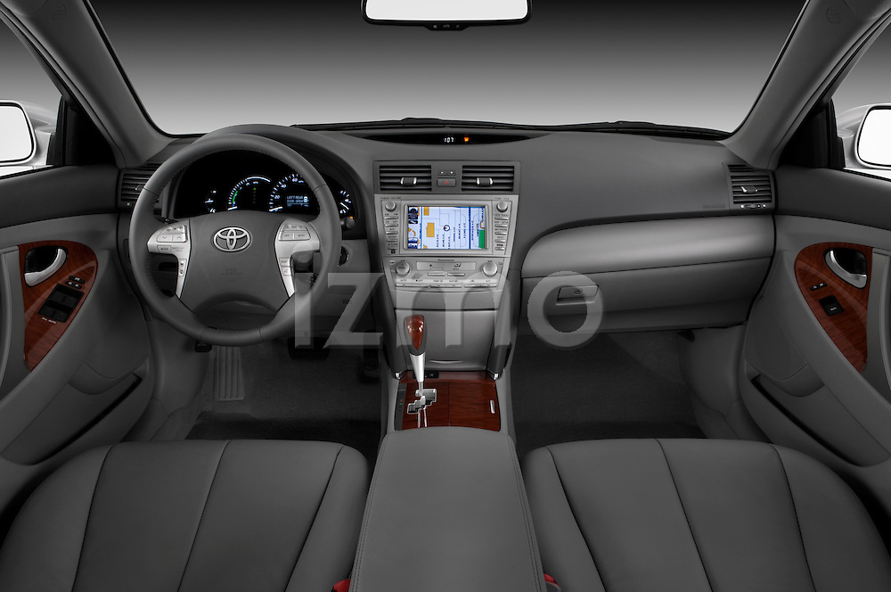 Straight dashboard view of a 2010 Toyota Camry Hybrid.