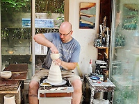 Potter throwing clay in his studio, Scargo Pottery, Dennis, Cape Cod, MA