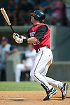 Carolina center fielder Brett Carroll (29) follows through on his swing versus Tennessee at Five County Stadium in Zebulon, NC, Sunday, July 2, 2006.  The Mudcats defeated the Smokies 4-0.