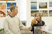 """A father & daughter have fun in the exhibition, """"Heart of Brazil"""" by Sue Cunninham. Open Day at Kingston College when prospective students and their parents look around."""