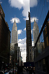 The Chrysler Building reflected on a glass building on 42th street