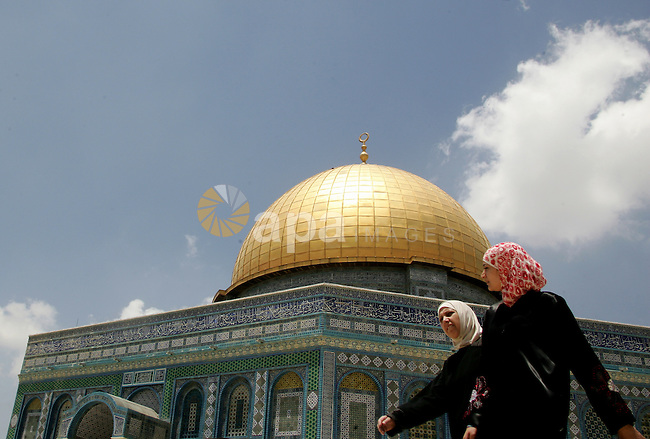 Palestinian Muslim women walk in front of the Dome of Rock after Friday prayers in the Al Aqsa Mosque compound, also known to Jews as the Temple Mount, in Jerusalem's old city on May 28, 2010. Photo by Mahfouz Abu Turk