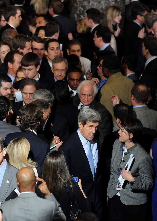 Sen. John Kerry (D-Mass.) makes his way through the crowd of media in Statuary Hall after the State of the Union address on Wed. Jan. 27, 2010. (Amanda Lucidon)