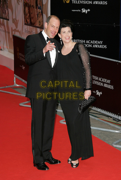 PHIL SPENCER & KIRSTY ALLSOPP.Red Carpet Arrivals for the British Academy Television Awards 2008, held at the London Palladium, London, England, .April 20th 2008. .BAFTA BAFTA's full length black dress tuxedo suit bow tie sheer sleeves hand pointing .CAP/AH.©Adam Houghton/Capital Pictures.
