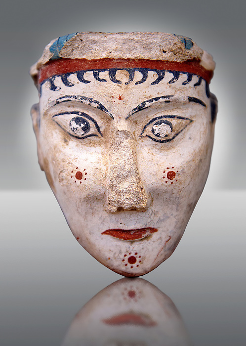 A unique plaster head of a women, possibly a goddess of sphinx, one of the few examples of Mycenaean plater art. The severe expression is excentualted by red and black paint and the small hair curls fall from below a polos 9 a cylindrical cap). From one of the cult areas of the acropolis of  Mycenae, Greece. 13th century BC, cat no: 4575,  National Archaeological Museum, Athens.