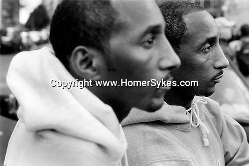 New York USA. Twins at a Smash the Klan Rally at City Hall. 1999