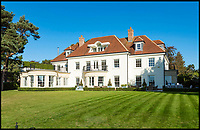 BNPS.co.uk (01202 558833)<br /> Pic: Savills/BNPS<br /> <br /> Three-mendous!<br /> <br /> Colonial style main house.<br /> <br /> Stunning seaside estate overlooking Sandbanks that wouldn't look out of place in the Hollywood Hills - and you get three properties for your &pound;9 million price tag.<br /> <br /> You get three luxury homes for the price of one with this spectacular private coastal estate - but they will still need deep pockets as the trio of properties are on the market for &pound;8.995m.<br /> <br /> The Mulberry House Estate is in the leafy Canford Cliffs area of Poole, Dorset, and has a grand five-bedroom mansion, a second detached five-bedroom house and a two-bedroom gate house.<br /> <br /> Locals describe the Canford Cliffs area as the 'Hollywood Hills' of the coastal property hotspot, more refined and less showy than the more 'Malibu style' Sandbanks peninsula that it overlooks.<br /> <br /> Offering beautiful views but with privacy and seclusion, and without the tourist crowds that the Sandbanks millionaire's enclave attracts.<br /> <br /> Estate agent Savills say the sale is a &quot;unique opportunity&quot; as the 2.2 acre Mulberry property is the only private estate in the area.