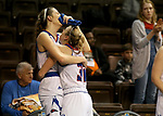 SIOUX FALLS, SD - MARCH 19: Seniors Tess Bruffey #54 and teammate Delaney Gaddis #32 from Lubbock Christian embrace as the buzzer sounds ending their season in a 72-62 loss to Central Missouri during their quarterfinal game at the 2018 Elite Eight Women's NCAA DII Basketball Championship at the Sanford Pentagon in Sioux Falls, SD. (Photo by Dave Eggen/Inertia)