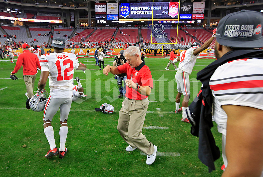 Buckeye cornerbacks coach Kerry Coombs dances with players after after beating Notre Dame Fighting Irish during the Fiesta Bowl in the University of Phoenix Stadium on January 1, 2016.  (Dispatch photo by Kyle Robertson)