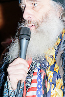 Standing next to ponies and with a boot on his head, Satirical presidential candidate Vermin Supreme delivers a stump speech at Ten Rod Farm in Rochester, New Hampshire. Supreme's platform advocates a pony-based economy, using zombies to solve the energy crisis, and other outlandish ideas. Supreme has been on the New Hampshire primary ballot in 2008 and 2012, though he began running for president in 1992. Vermin Supreme will be on the Democratic party ballot in the 2016 New Hampshire primary.
