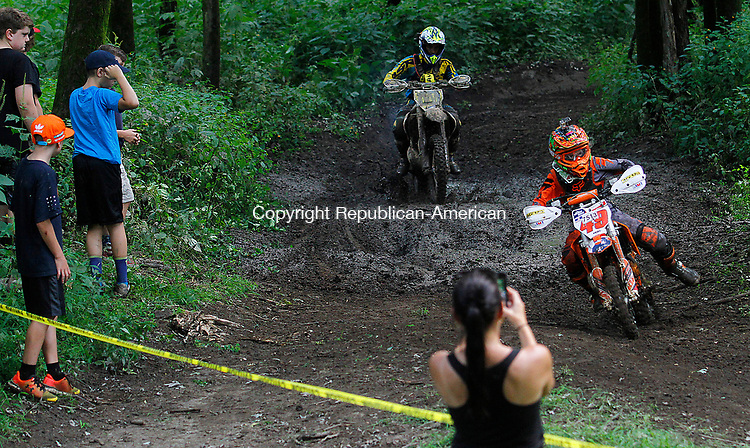 THOMASTON, CT - 19 AUGUST 2017 - 081917JW01.jpg -- Spectators watch riders in the 65CC race during the Pathfinders Motorcycle Club of Connecticuts Dam Good National Hare Scramble Saturday morning at Thomaston Dam. Riding continues Sunday with the PRO/AM series. Jonathan Wilcox Republican-American