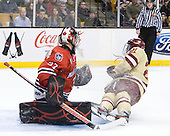 Chris Rawlings (Northeastern - 37), Steven Whitney (BC - 21) - The Boston College Eagles defeated the Northeastern University Huskies 7-1 in the opening round of the 2012 Beanpot on Monday, February 6, 2012, at TD Garden in Boston, Massachusetts.