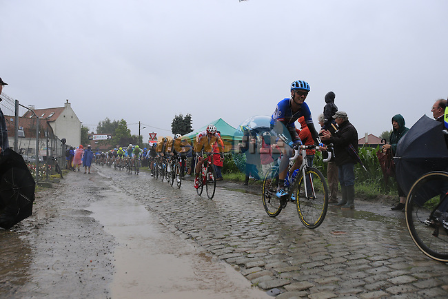 Riders including Johan Van Summeren (BEL) Garmin-Sharp tackle the1st cobbled sector 9 from Gruson to Crossroads de l'Arbe during Stage 5 of the 2014 Tour de France running 155.5km from Ypres to Arenberg. 9th July 2014.<br /> Picture: Eoin Clarke www.newsfile.ie