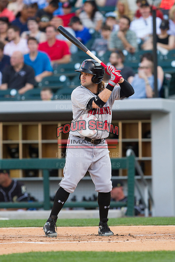 Jaff Decker (14) of the Indianapolis Indians at bat against the Charlotte Knights at BB&T Ballpark on May 23, 2014 in Charlotte, North Carolina.  The Indians defeated the Knights 15-6.  (Brian Westerholt/Four Seam Images)