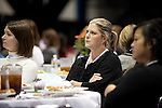 Women at the Conference listen intently to Marion Jones' story
