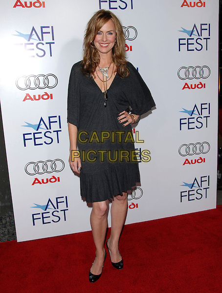 MELORA HARDIN.Attends The AFI Film Festival Screening of Lions for Lambs held at The Cinerama Dome in Hollywood, California on .November 1st, 2007  .full length grey gray dress hand on hip silver necklace.CAP/DVS.©Debbie VanStory/Capital Pictures