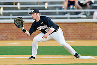 First baseman Matt Conway #25 of the Wake Forest Demon Deacons waits for a throw against the Miami Hurricanes at Gene Hooks Field on March 18, 2011 in Winston-Salem, North Carolina.  Photo by Brian Westerholt / Four Seam Images