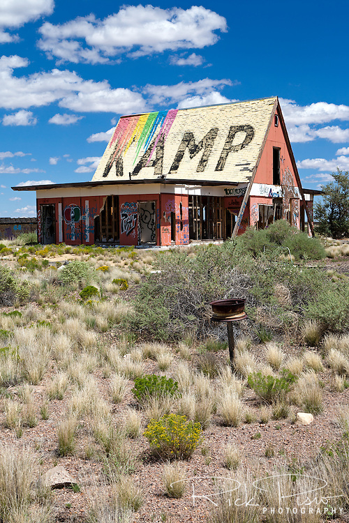 "Two Guns' graffiti covered campground store. Two Guns is located in Arizona, east of Flagstaff, on what was formerly Route 66. Two Guns was originally called ""Canyon Lodge"" when the National Trail Highway moved westward. Later, the National Trail was re-named Route 66, the site's name was changed to Two Guns, because the proprietor of the facilities located there was one Henry E. Miller, who called himself ""Two Gun Miller."" During the heyday of Route 66, Two Guns became one of the numerous tourist traps along the way, with a gas station, overnighting accommodations, a food emporium, as well as a zoo. Two Guns went into decline with the building of the Interstate."