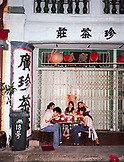 SINGAPORE, Asia, Chinatown, friends having food at outdoors restaurant