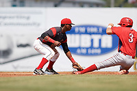 Batavia Muckdogs second baseman Samuel Castro (5) tags out Jake Scheiner (3) attempting to steal during the first game of a doubleheader against the Williamsport Crosscutters on August 20, 2017 at Dwyer Stadium in Batavia, New York.  Batavia defeated Williamsport 6-5.  (Mike Janes/Four Seam Images)