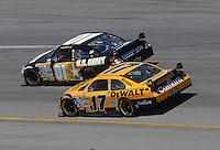 May 6, 2007; Richmond, VA, USA; Nascar Nextel Cup Series driver Mark Martin (01) races alongside Matt Kenseth (17) during the Jim Stewart 400 at Richmond International Raceway. Mandatory Credit: Mark J. Rebilas