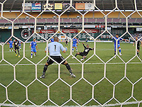 DC United defender Julius James (2) head the ball against El Salvador National Team goalkeeper Dagoberto Portillo (1)   DC United defeated El Salvador National Team 1-0 in a international charity match at RFK Stadium, Saturday June 19, 2010.