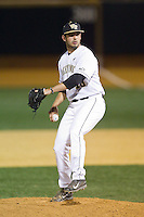 Wake Forest Demon Deacons closer Aaron Fossas (18) in action against the High Point Panthers at Wake Forest Baseball Park on April 2, 2014 in Winston-Salem, North Carolina.  The Demon Deacons defeated the Panthers 10-6.  (Brian Westerholt/Four Seam Images)