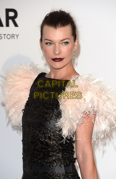 CAP D'ANTIBES, FRANCE - MAY 22: Milla Jovovich attends amfAR's 21st Cinema Against AIDS Gala, Presented By WORLDVIEW, BOLD FILMS, And BVLGARI at the 67th Annual Cannes Film Festival on May 22, 2014 in Cap d'Antibes, France. <br /> CAP/CAS<br /> &copy;Bob Cass/Capital Pictures