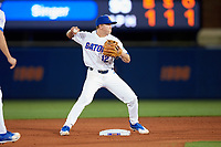 Florida Gators second baseman Blake Reese (12) turns a double play during a game against the Siena Saints on February 16, 2018 at Alfred A. McKethan Stadium in Gainesville, Florida.  Florida defeated Siena 7-1.  (Mike Janes/Four Seam Images)