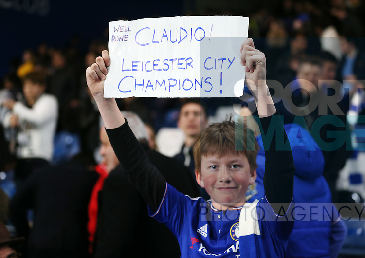 A Chelsea fan celebrates Leicester?s title during the Barclays Premier League match at Stamford Bridge Stadium.  Photo credit should read: David Klein/Sportimage