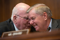 United States Senator Patrick Leahy (Democrat of Vermont), left, and United States Senator Lindsey Graham (Republican of South Carolina), right, converse as US Secretary of State Mike Pompeo testifies before the US Senate State, Foreign Operations, and Related Programs Subcommittee on April 9, 2019 regarding the State Department's budget request for fiscal year 2020.<br /> Credit: Stefani Reynolds / CNP/AdMedia