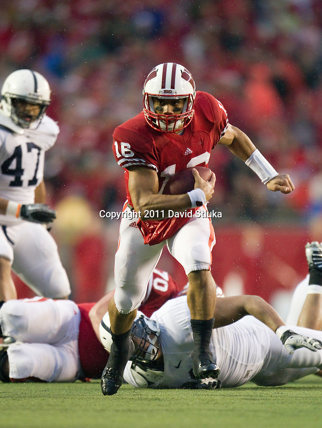 Wisconsin Badgers quarterback Russell Wilson (16) scrambles for a first down during an NCAA Big Ten Conference college football game against the Penn State Nittany Lions on November 26, 2011 in Madison, Wisconsin. The Badgers won 45-7. (Photo by David Stluka)