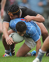 Wellington College captain Zek Sopoaga tries to rip the ball from Haize Alatipi during the Wellington Secondary Schools premier rugby final between Silverstream and Wellington College at Hutt Recreation Ground, Petone, Wellington, New Zealand on Sunday, 12 August 2012. Photo: Dave Lintott / lintottphoto.co.nz