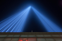 The twin beams of light of the Tribute in Light, an annual memorial to the events of September 11, 2001, shine into the night sky in New York City on Tuesday, September 11, 2012 from the installation on the roof of the Battery Parking Garage on West Street above the entrance to the Battery Tunnel.  The streaks of light visible inside the beams are birds flying in the lights.