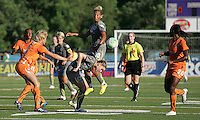 Daphne Koster (4) of Sky Blue, and Amy Rodriguez (8) and Lianne Sanderson (10) of Philadelphia, scramble for the ball in midfield.  Philadelphia Independence defeated Sky Blue, 2-1, at John Farrell Stadium in West Chester, PA.