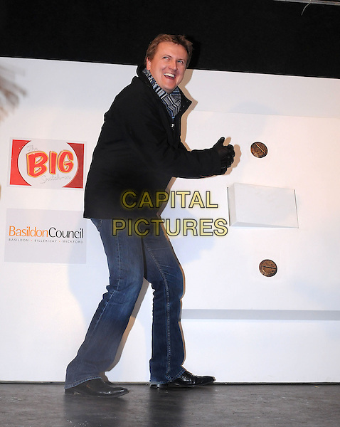 ALED JONES .Switches on the Christmas lights in  Basildon, Essex, England, UK, .18th November 2010.full length striped scarf grey gray black jacket jeans side .CAP/BRC.©Ben Rector/Capital Pictures.