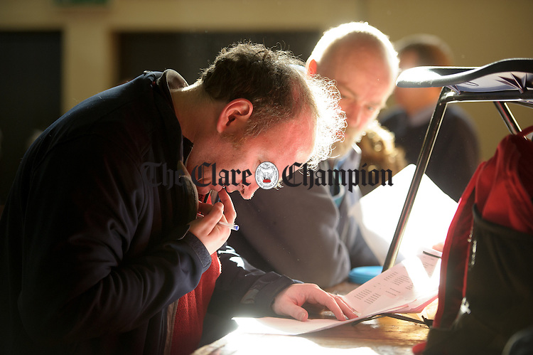 John Cassidy, co-ordinator, works out his results table at the Clare Community games chess county finals in St Flannan's college, Ennis. Photograph by John Kelly.